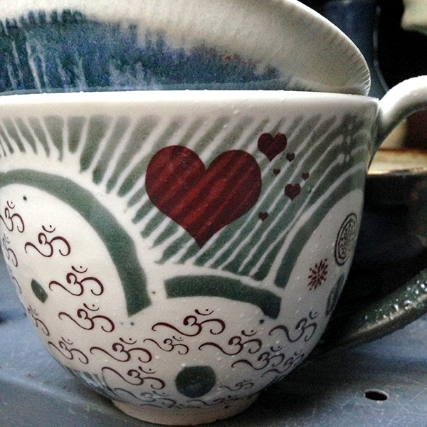 Stripes shining through the decal heart on Carol Whitney's mug