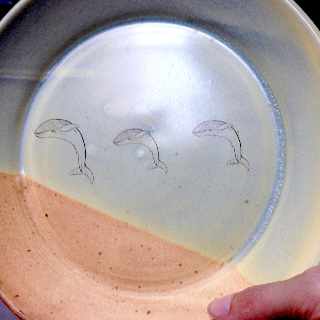 Leah's whale plate - love the repetition and the way the two glazes create perspective